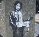 banksy-painted-charles-manson-as-a-hitchhiker-on-a-london-street-corner-in-2005